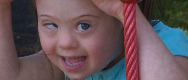 image of young girl smiling on playground