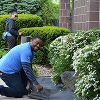 volunteer working in garden area