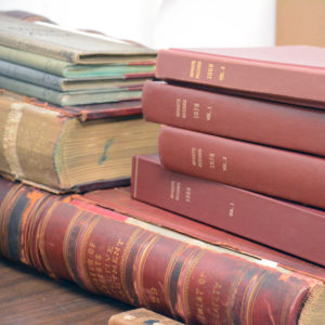 stack of old historical books