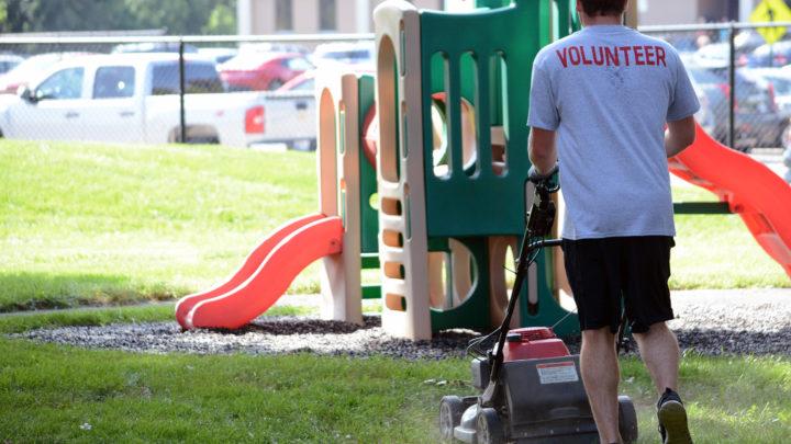 volunteer working in playground
