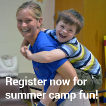 smiling boy with camp counselor