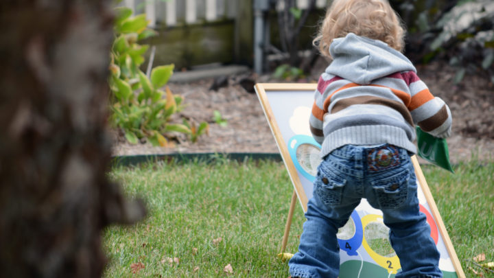 small child playing in garden