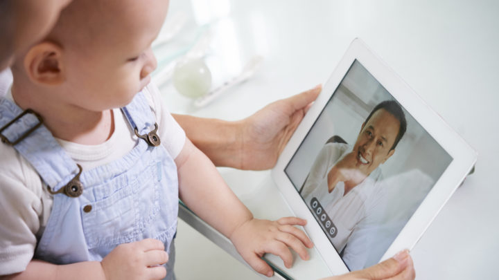 baby with mom on telehealth appointment