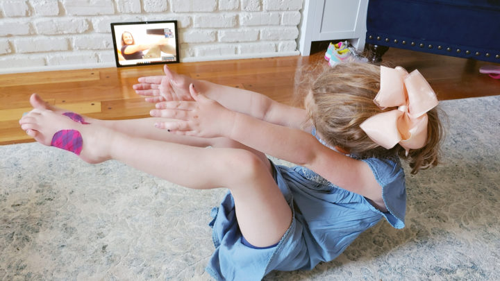 young girl participating in a telehealth physical therapy appointment