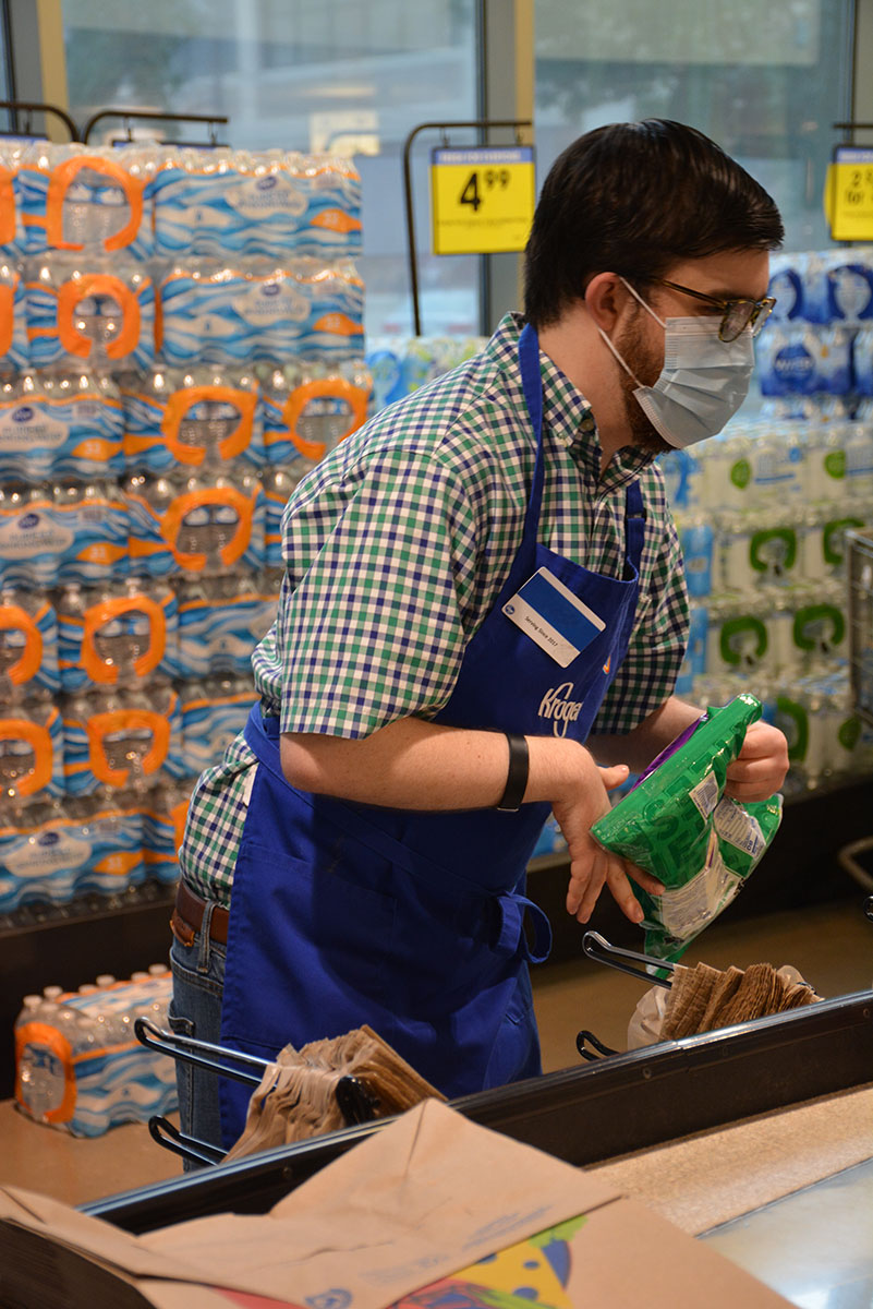 Man working at a grocery store.