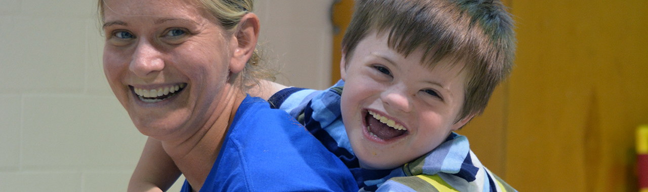 An ESC employee enjoying time with a child