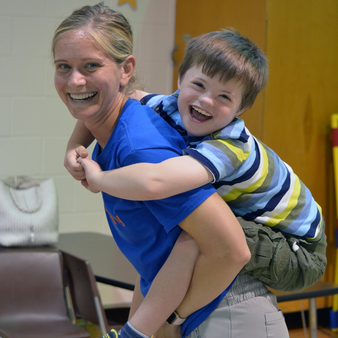 ESC staff member playing with a child