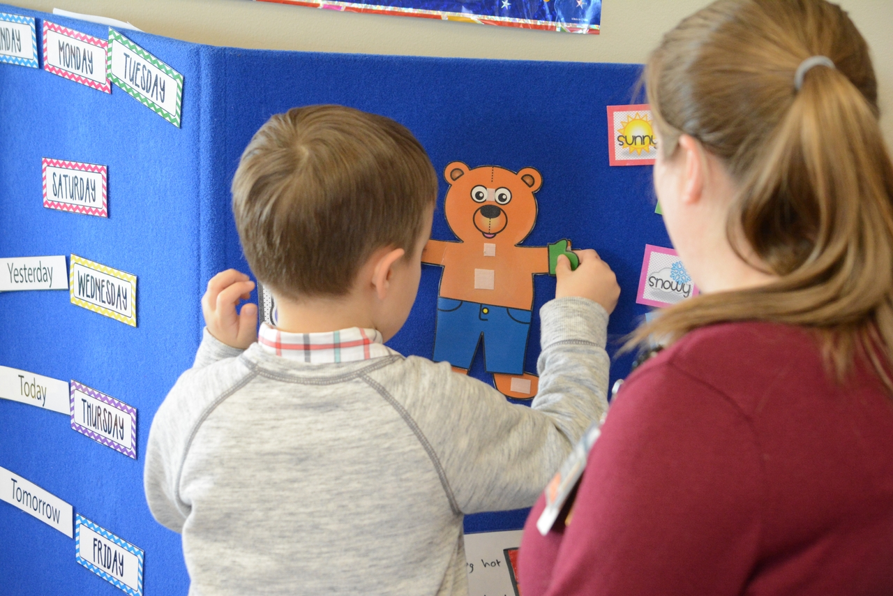 Child creating a paper animal