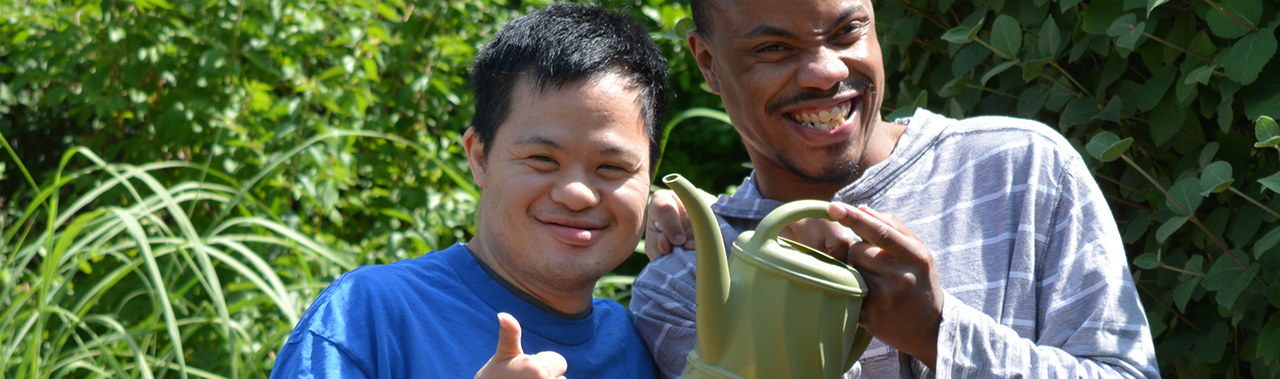 Two young men showing thumbs up