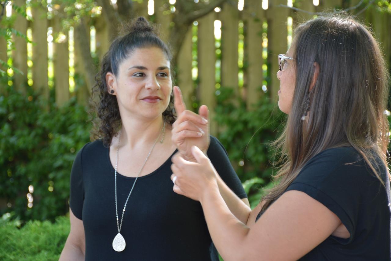 Two deaf ladies signing
