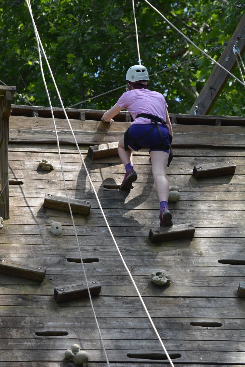 a child climbing on a climbing wall