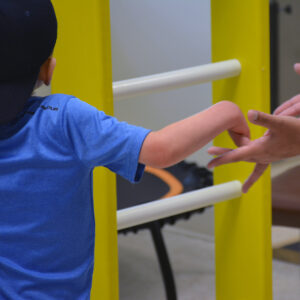 support photo of young child holding hands