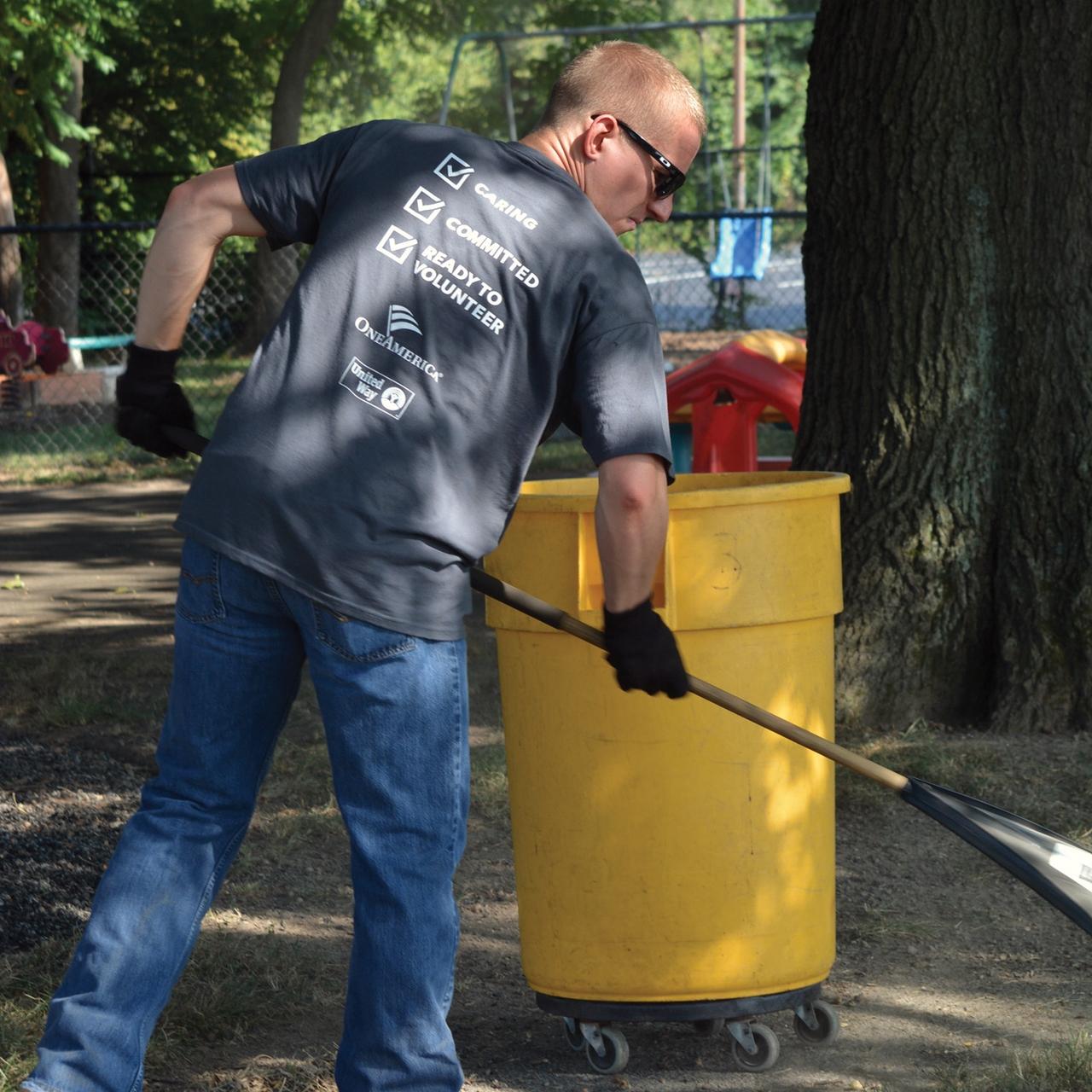 Volunteer raking leaves
